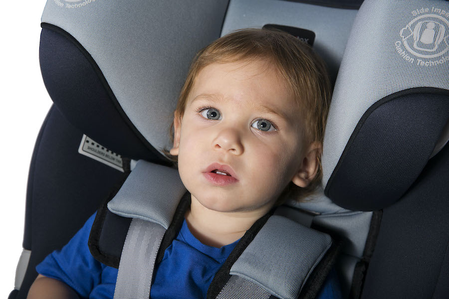 Photo of baby in rear-facing car seat.